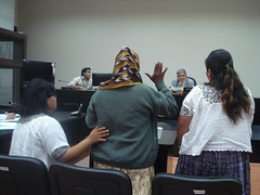 One of the victims testifying before the judge, with the support of a psychologist and a translator. Credit: Danilo Valladares/IPS (IPS Inter Press Service) Tags: rape indigenouspeople indigenouswomen armyabuses
