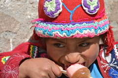 Girl Eating a Popsicle (vatzi) Tags: peru girl america south pisac peasant