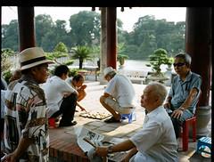 Hoan Kiem Lake, August 2012 (Hanoi1933) Tags: summer lake playing hot men mediumformat 645 fuji hats streetphotography lac games vietnam chapeaux hanoi t chaud hommes hoankiem jeux fuji645