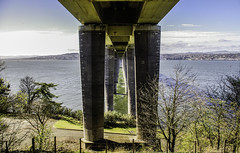 Under Tay Road Bridge (Brian Travelling) Tags: dundee tay rivertay taybridge bridge roadbridge pillars uprights water sky clouds cloud river scotland fife pentaxkr pentax pentaxdal span navigationchannel newportontay