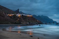 As night falls (helena678) Tags: village mountains sea water beach lights houses coast rocks waves clouds blue dark night longexposure tenerife canaryislands spain