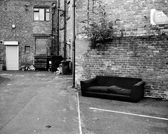 Abandoned Sofa - South Shields (Richard James Palmer) Tags: mamiya7ii mamiya 7ii 80mm ilford hp5 ilfordmicrophen microphen ishootfilm shoot film iso 400 iso400 ilfordhp5 f4 newcastle northeast north east street photography landscape black white rangefinder medium format 120 filmisnotdead analogue documentary epsonperfectionv700 epson v700 1125 landscapes newcastleupontyne upon tyne tyneandwear northern uk england urban melancholy art fineart new overcast isolated walkabout 2016 gritty gloomy trapped blackandwhite monochrome