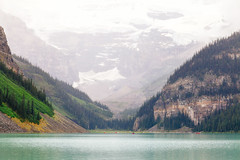 Floating Through (michaelnugent) Tags: canon eos 5d mark ii ef 24 105 mm l lens lake louise banff alberta explore travel canada canadian rocky mountains lakeshore portrait landscape scenery trees snow clouds overcast rain canoe reflections