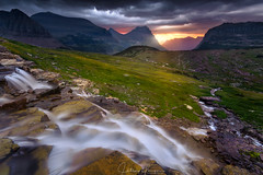 Glacial waters 2 (hillsee) Tags: glaciernationalpark mountains mood sky storm clouds waterfall flow montana rockies light sunrise dawn