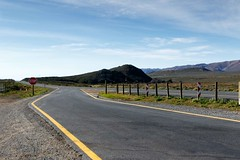 The Road starts here to Tankwa Karoo (markdescande) Tags: africa wind dry natural cape nature dawn south background karoo road outside geology gannaga african sky environment valley stone path grass scenic landscape sunset tankwa twist rises fog eastern outdoor clouds arid desert dusk gravel sun blue ravine rock geological pass cloud sunrise mist wild park nobody misty national mountain