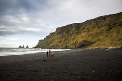 People on the black beach at Vk  Mrdal (breakbeat) Tags: icelands0284 vkmrdal vk beach black volcanic sand travel travelphotography lonelyplanet traveltheworld winter bucketlist shore landscape coast cliff mountain outdoor people family child redjacket waves