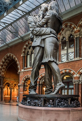 (The Meeting Place Sculpture by Paul Day) - St Pancras rail station (Olympus OMD EM5II & mZuiko 12mm f2 Prime) (1 of 1) (markdbaynham) Tags: london londoner st pancras rail station building urban metropolis omd detail em5ii csc evil mft m43 m43rd micro43 micro43rd zd mz zuiko mzuiko 12mm f2 prime microfourthirds sculpture paul day meeting place belgium city