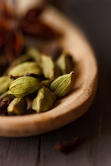 Cardamom close up. (ZakariaSnow) Tags: food brown plant macro green cooking nature kitchen closeup asian wooden healthy pod flavor natural background indian spice group seed dry bowl fresh gourmet exotic pile condiment medicine taste spicy aromatic herb herbal pods seasoning aroma ingredient cardamom cardamon flavoring