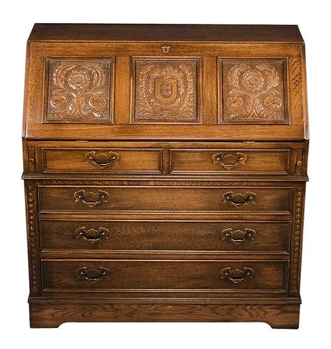 Carved oak bureau