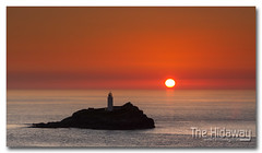 Island sunset (Simon Bone Photography) Tags: sea sky cloud sun lighthouse reflection silhouette island cornwall godrevy cornishcoast cornishsunsets wwwthehidawaycouk canoneos7d canonef24105mmlf4 hitechnd09reversegrad