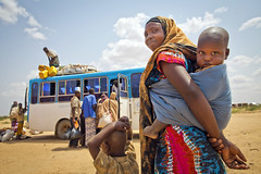 Dollo Ado, a Year After the Somalia Famine (UNHCR) Tags: africa woman bus children women refugees border somali arrival ethiopia photoset unhcr hornofafrica photooftheday newarrivals transitcentre somalirefugees unrefugeeagency eastandhornofafrica unitednationshighcommissionerforrefugees doloado dolloado somalirefugeesindoloado
