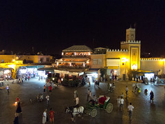 Djemaa el fna square (Ral Villaln) Tags: africa street old city travel vacation people holiday building art heritage tourism monument bike architecture night walking square evening town market african muslim islam traditional religion crowd culture landmark el mosque tourist arabic morocco arab marrakech souk medina marrakesh arabian oriental seller moroccan islamic crowded touristic fna jemaa elfna djemaa djmaa