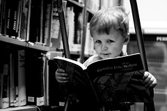 in library /explored/ (I.Dostál) Tags: boy portrait bw white black face canon children reading book blackwhite child view library bn cb explored blackandwhiteonly janabill