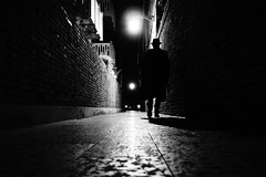 nouvelle vague (Emiliano Grusovin) Tags: street city venice shadow blackandwhite bw hat silhouette night alley strada mood sony ombra highcontrast evil bn pancake alpha cinematic 16mm venezia f28 notte biancoenero cappello filmnoir città altocontrasto mirrorless nex3