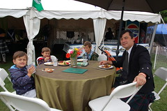 The Chong boys enjoy lunch at the Fergus Highland Games, where Michael was the Guest of Honour.  Michael is dressed in the Davidson tartan, belonging to wife Carrie's family.