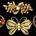 238. Assorted Costume Jewelry Brooches
