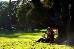 The reader (Jorge Tarlea) Tags: california ca usa tree grass bike reading unitedstates leer lawn bicicleta read rbol gorra bicicle westcoast estadosunidos hierba eeuu leyendo csped peakedcap jorgetarlea
