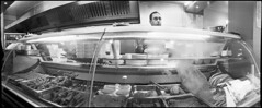 Kebab shop owner decapitated by Widelux (*monz*) Tags: blackandwhite bw panorama chicken film bread kodak iso400 smoke trix spoon 11 curry panoramic meat steam widelux swinglens plates cooker nan kebab f28 skewer 9m 20c beheading xtol guillotine kabab decapitation behead f7 26mm monz autaut