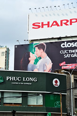 Be sharp, be close and... (Roving I) Tags: mixedmessages signs sharp closeup phuclong coffeehouses shops cafes billboards advertising technology toothpaste drinks beverage saigon hcmc hochiminhcity vertical vietnam
