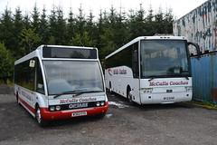 W302 EYG (ex KLX 108), an Optare Solo M850, and PJI 3746 (ex MV02 UMD, SIL 1075 and originally MV02 UMD), a Volvo B12M/Van Hool Alizee, of McCall's Coaches, Lockerbie. (C15 669) Tags: w302 eyg pji 3746 mccalls lockerbie