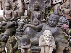 Buddhas and friends (SM Tham) Tags: asia indonesia bali island candidasa shop stonecarvings statues buddhas monk ganesha elephantgod dog frog outdoors