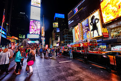 Times Square in New York (` Toshio ') Tags: toshio newyork newyorkcity timessquare neon lights manhattan midtown city people tourists crowds square fujixe2 xe2 usa america bus broadway palacetheater anamericaninparis