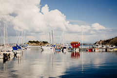 Styrs Port (freyavev) Tags: port hafen styrs island sweden gotland sky clouds reflections blue outdoor boats sea water redhouse sverige gothenburg schweden scandinavia