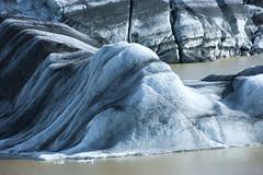 a melting glacier in mourning gown (lunaryuna) Tags: iceland southeasticeland svinafellsjokullglacier glacier glacialice melting thegreatmeltdown aglacierinmourning globalwarming textures sadbeauty spring season seasonalchange lunaryuna natureabstract