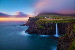 A Different World | Gsadalur, Faroe Islands (v on life) Tags: gsadalur faroeislands waterfall longexposure sunrise vgar dawn cliffs mountains clouds water ocean sea waves village colors grass