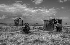 Barren (Steve's Photography :-)) Tags: uk england sky blackandwhite bw rot beach rotting monochrome clouds canon mono kent rust desert timber decay shed shingle pebbles huts hut dungeness winch derelict hdr decaying sheds 550d steveclancy