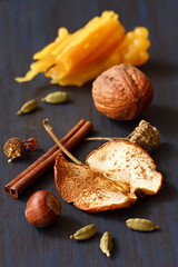 Apple, nuts and spices. (ZakariaSnow) Tags: blue food brown apple closeup fruit sticks mix natural cinnamon background board rustic decoration nuts walnuts spices slice dried aromatic cardamom hazelnuts