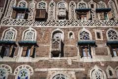 ornate window in the old city of Sana'a, yemen (anthony pappone photography) Tags: world pictures travel windows architecture night digital canon lens photography photo republic foto image picture culture palace best unesco arab arabia yemen fotografia sanaa ramadan reportage photograher sejima suk finestre arabo yemeni phototravel yaman arabie arabiafelix arabieheureuse  arabianpeninsula        alyaman yemenpicture yemenpictures ornatewindows eos5dmarkii   carvedwindows  mediorient