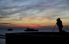 (The New Motive Power) Tags: shadow sea man abandoned water ferry sunrise person dawn boat early glow quiet photographer fort vibrant military horizon victorian historic deck isleofwight solent portsmouth serene passing distance fortress derelict nomansland defence helipad horsesand canon7d