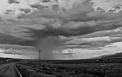 The Coming Storm (tarheelz11) Tags: road sky storm mountains field rain clouds blackwhite highway stormclouds