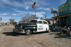 Seligman USA (Curtis Gregory Perry) Tags: seligman arizona 1954 chrysler new yorker police car ghost town flag american america us cops route 66 historic coffee shop copper cart nikon d800e jewelry espresso worldcars usa unitedstates united states
