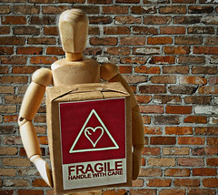Fragile...Handle With Care! (Through Serena's Lens) Tags: mm macromondays handlewithcare box small wooden mannequin label fragile caution texture brickwall