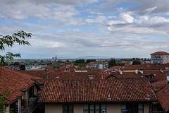lo sguardo aperto (Clay Bass) Tags: 50mm saluzzo cityscape clouds d750 natural nikon roofs sky
