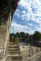 (AmyEAnderson) Tags: town village steps streetlight streetlamp sidewalk cement arles france bouchesdurhone provence clouds