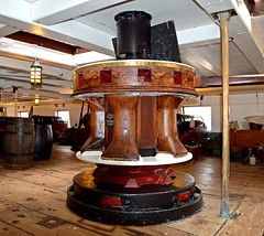 The Capstan (rustyruth1959) Tags: nikon nikond3200 tamron16300mm hmstrincomalee hartlepool hartlepoolhistoricquay royalnavy museum ship frigate capstan indoor deck wood barrels planks floor history lamp pole