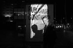 public under scrutiny (Alexandre Dulaunoy) Tags: publicunderconstruction denhaag sooc bw street bynight lights people performance noiretblanc nb art noirblanc night