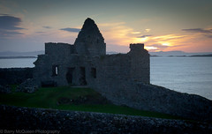 Sunset over Dunluce Castle (bazmcq) Tags: ocean uk ireland sea nature beauty canon landscape eos coast seaside unitedkingdom britain united kingdom cliffs atlantic northernireland british ulster portrush antrim 500d northernirelandphotography barrymcqueen yahoo:yourpictures=landscape yahoo:yourpictures=yoursummer
