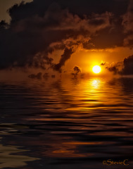 Rising Sun (StevieC-Photography) Tags: sea sky cloud sun sunlight seascape reflection nature rock vertical sunrise outdoors island photography spain nopeople dramaticsky risingsun scenics tranquilscene beautyinnature breakingdawn colourimage steviec ibizaisland ibizasunrise