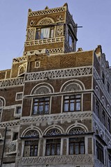 Yemeni-style palaces with ornate windows, old sana'a, yemen (anthony pappone photography) Tags: world pictures travel windows architecture digital canon lens photography photo republic foto image picture culture palace best unesco arab arabia yemen fotografia sanaa ramadan reportage photograher sejima suk finestre arabo yemeni phototravel yaman arabie arabiafelix arabieheureuse اليمن arabianpeninsula يمني صنعاء 也門 йемен جنبية 공화국 υεμένη alyaman yemenpicture yemenpictures ornatewindows eos5dmarkii 아랍 यमन carvedwindows 예멘 mediorient