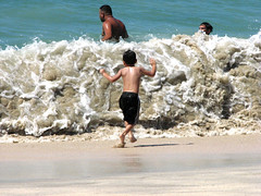 something bigger to deal with (Luis Eduardo ) Tags: boy beach fun sand wave foam luismosquera