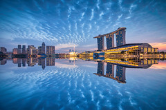 Blu Duo (Scintt) Tags: city morning blue sky urban reflection water skyline clouds marina sunrise way dawn lights hotel mirror bay early hall singapore long exposure cityscape slow place peaceful images calm casino full tokina hour frame shutter getty cbd sands resorts mbs raffles integrated shenton 1116 scintillation scintt d800e gettysingapore