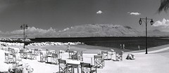 Esplanade (Jackobo) Tags: sea people panorama mountains clouds port cafe rocks chairs corinth greece tables infrared lamps stockcategories