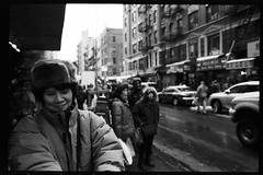 one day in chinatown (-{ ThusOriginal }-) Tags: 135 28mm bw blackandwhite f3t film fujineopan1600 hat monochrome nyc street thusihaveseen winter thusoriginal newyork city scan