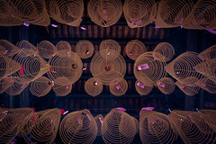 A temple from below (jurgenvonbeyme) Tags: spirals incense perspective southeastasia religion vietnam asia temple