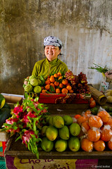 Fruit Merchant #2 (davidkoiter) Tags: travel portrait woman smile hat wall fruit canon eos vietnamese village market vietnam 7d l series local selling merchant f4 1740 2012 f4l koiter davidkoiter