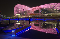Yas Hotel, Abu Dhabi (Charn High ISO Low IQ) Tags: longexposure nightphotography pink blue marina eos lights hotel boat uae abudhabi waterreflection yasisland canon600d yasmarina yashotel